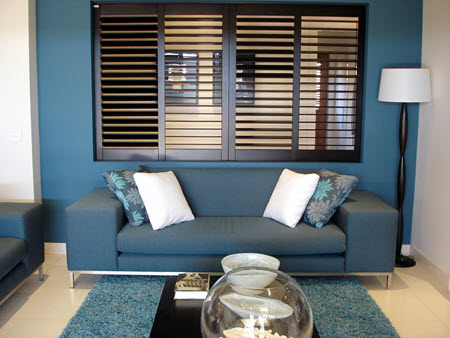 Design Trends for Window Coverings Near Newport Beach, California (CA) like Wood Shutters in Living Rooms